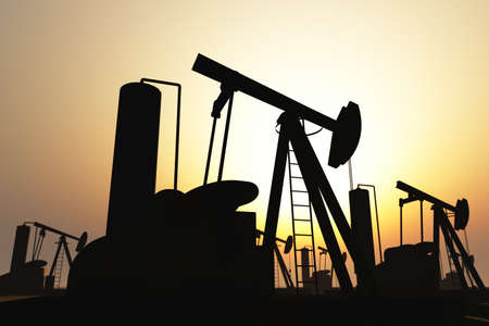 Oil Pumps on Field in the sunset 3D render Stock Photo