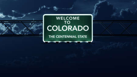 state of colorado: Colorado USA State Welcome to Highway Road Sign at Night