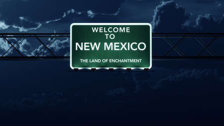 enchantment: New Mexico USA State Welcome to Highway Road Sign at Night Stock Photo