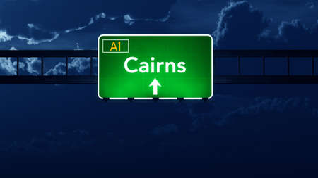 cairns: Cairns Australia Highway Road Sign at Night Stock Photo