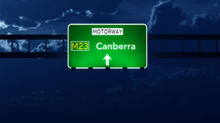 canberra: Canberra Australia Highway Road Sign at Night Stock Photo