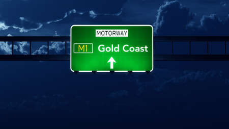 gold road: Gold Coast Australia Highway Road Sign at Night