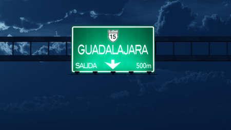 guadalajara: Guadalajara Mexico Highway Road Sign at Night Stock Photo