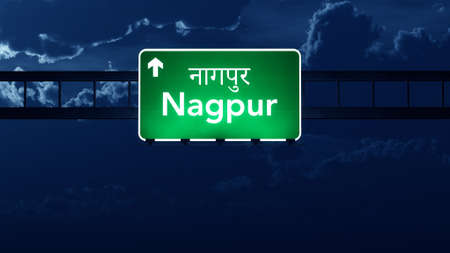 nagpur: Nagpur India Highway Road Sign at Night Stock Photo
