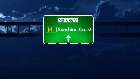 queensland: Sunshine Coast Australia Highway Road Sign at Night Stock Photo