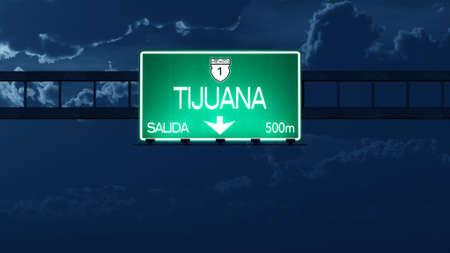 highway night: Tijuana Mexico Highway Road Sign at Night Stock Photo