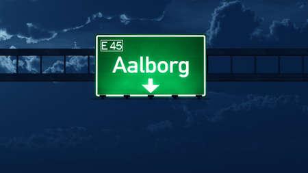 highway night: Aalborg Denmark Highway Road Sign at Night 3D artwork Stock Photo