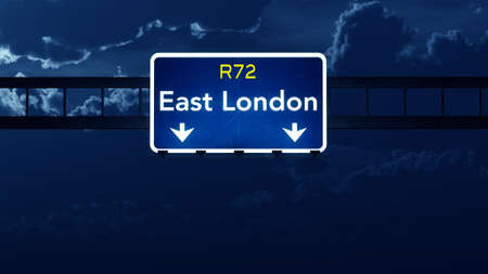 london night: East London South Africa Highway Road Sign at Night 3D artwork Stock Photo