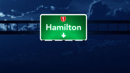 hamilton: Hamilton New Zealand Highway Road Sign at Night 3D artwork Stock Photo