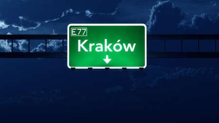 krakow: Krakow Poland Highway Road Sign at Night 3D artwork Stock Photo
