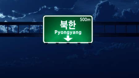 pyongyang: Pyongyang North Korea Highway Road Sign at Night 3D artwork Stock Photo