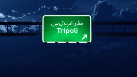 lybia: Tripoli Lybia Highway Road Sign at Night 3D artwork Stock Photo