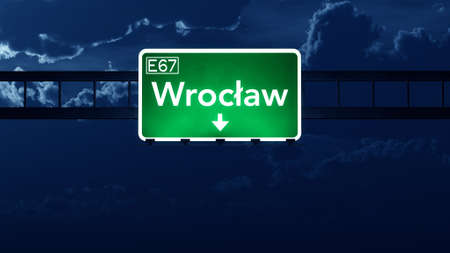 highway night: Wroclaw Poland Highway Road Sign at Night 3D artwork Stock Photo