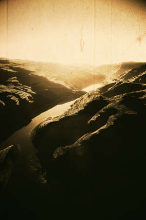 planar: Aerial shot of a Canyon with a Natural Fault Drainage Basin Lake 3D Artwork Illustration Vintage Design