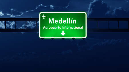 highway at night: Medellin Colombia Airport Highway Road Sign at Night 3D Illustration Stock Photo