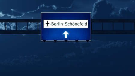 highway at night: Berlin Schonefeld Airport Highway Road Sign at Night 3D Illustration Stock Photo