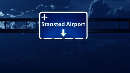 london night: Stansted London England UK Airport Highway Road Sign at Night 3D Illustration