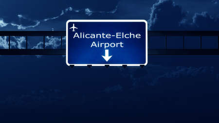nightfall: Alicante Spain Airport Highway Road Sign at Night 3D Illustration Stock Photo