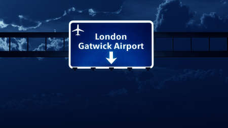 london night: Gatwick London England UK Airport Highway Road Sign at Night 3D Illustration Stock Photo