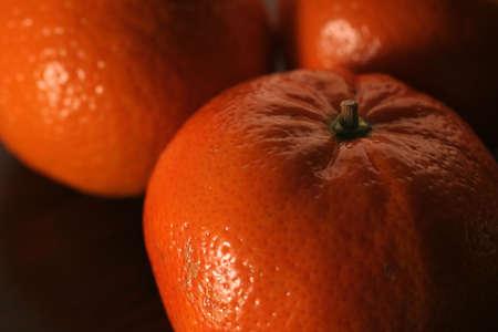 reticulata: Close up at three mandarins on dark background Stock Photo