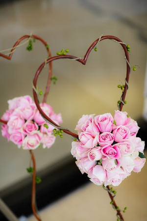 bouquet  pink roses with a heart shape. photo