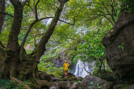 Beautiful waterfall with one person standing in Klong Lan National Park, Thailand Zdjęcie Seryjne