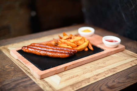 restaurant plate served with sausages and potatoes Standard-Bild