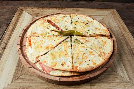 Wooden plank served sandwich pizza