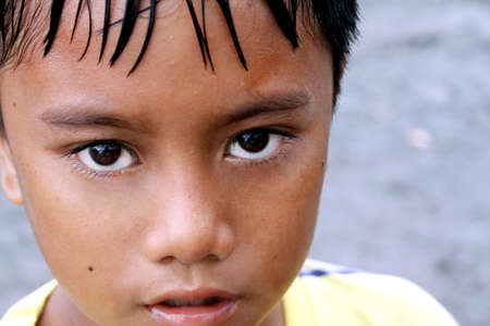 young boy look in camera photo