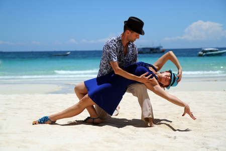honeymoon couple: couple dancing near ocean