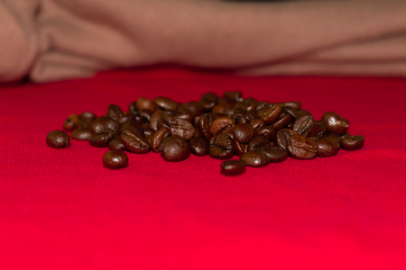 Coffee beans on red