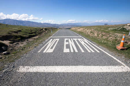 No Entry painted on a road in New Zealand Imagens
