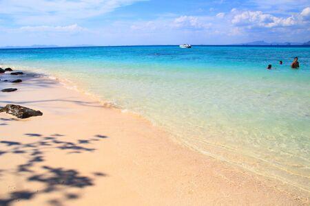 white sand beach with tree shadow at bamboo island, krabi. photo