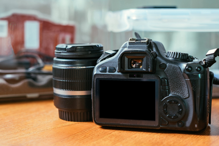 DSLR camera with lens on the wood table