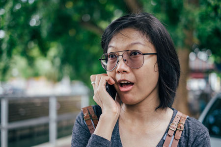 Woman calling with mobile phone disappointed on somethings. Stock Photo