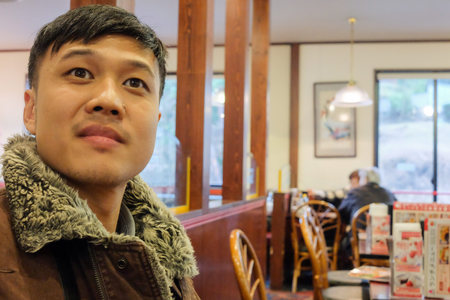 Man looking at toward camera at restuarant with surprised.
