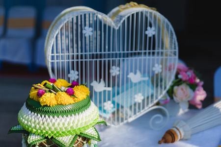 Heart shape cage with thai flower garland.