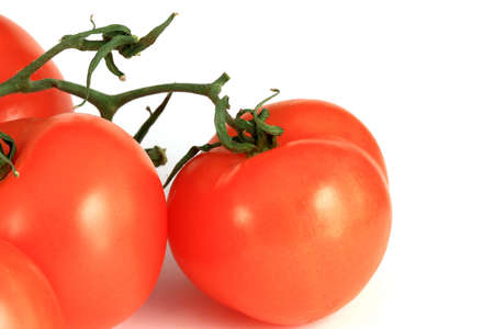 Three tomatos with a bit of shadow isolated on white