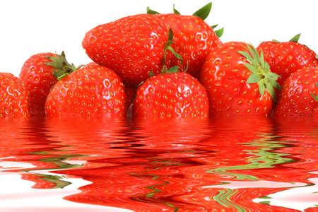 strawberrys: Many strawberrys on white and a water reflection Stock Photo
