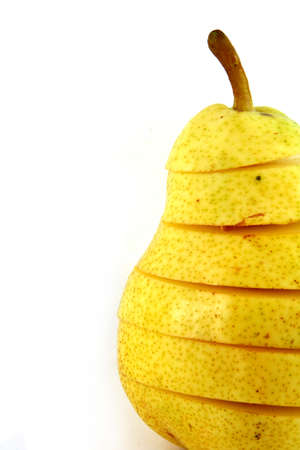 text space: Single pear cut in sections with text space Stock Photo