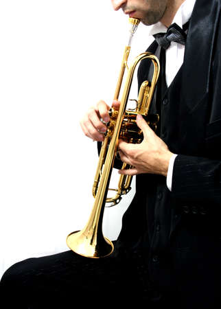 fingering: Trumpet music player in a luxury suit and his golden trumpet