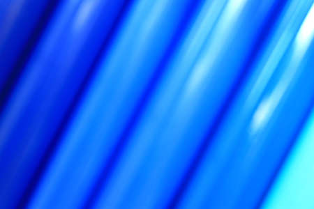 colored vinyl tubes as an abstract background blured