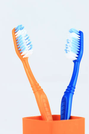 hygenic: Two tooth brushes close up in a glass