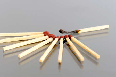 pyromania: Extincted matches on a grey as a hope concept Stock Photo
