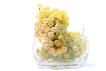 Close-up of grapes in a glass bowl on white  Archivio Fotografico