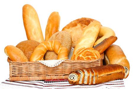 bread basket: Bread, loaf, cake, baton, crescent on white  Stock Photo