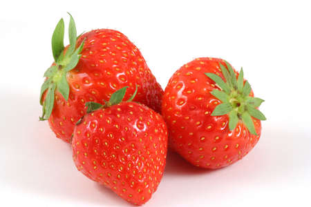 strawberrys: Three strawberrys close-up on white and a bit of shadow Stock Photo
