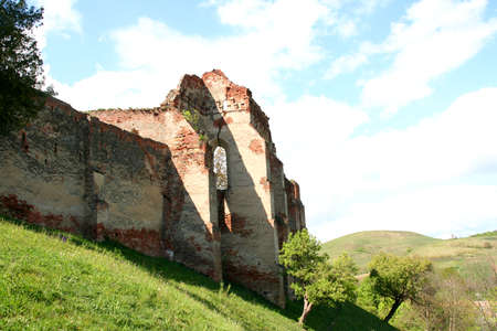 stronghold: Old medieval stronghold ruins on a hill, in Slimnic, Romania