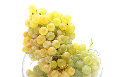 close-up of grapes in a glass bowl on white background Archivio Fotografico