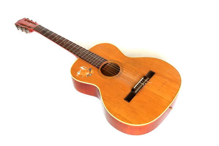 accoustic: Old acoustic guitar isolated on a white  Stock Photo